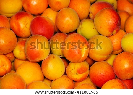 Baskets with fresh ripe apricots. Close up - stock photo