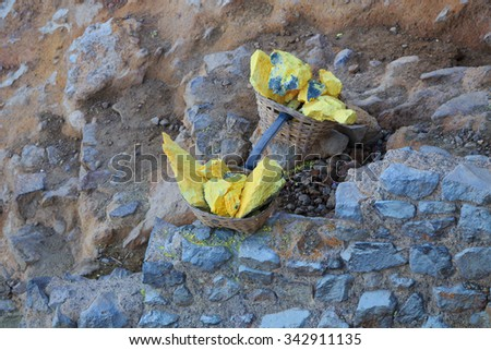 Baskets with sulphur (sulfur) at Kawah Ijen volcano crater, East Java, Indonesia - stock photo