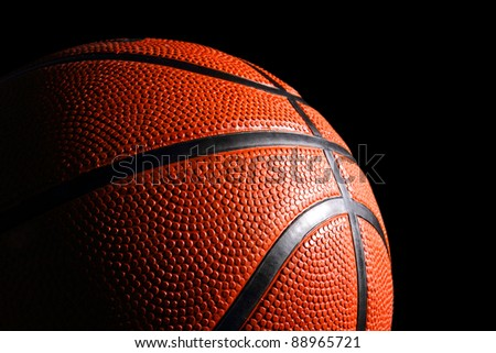 baskettball in front of black background - stock photo