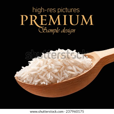 Basmati rice in a wooden spoon / cereal on wooden spoons isolated on black background with place for your text  - stock photo