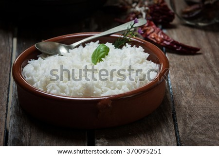 basmati rice on pot and butter chicken curry - stock photo