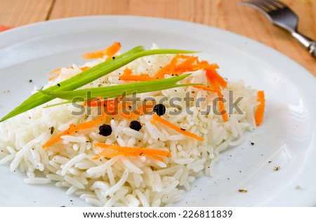 basmati rice with carrot, chive and bell pepper - stock photo