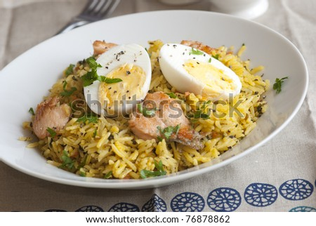 Basmati rice with pieces of trout fillet and boiled eggs in a bowl