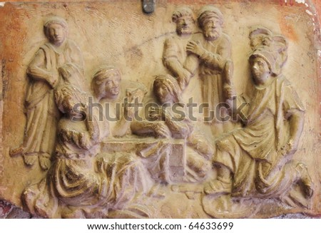 Basrelief with the nativity scene. The three kings visit the newborn Jesus - stock photo