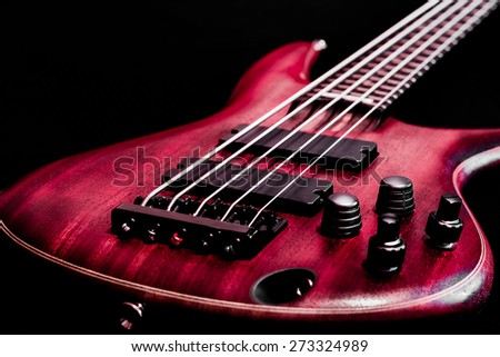 Bass guitar body view (low key, shallow depth of field) - stock photo