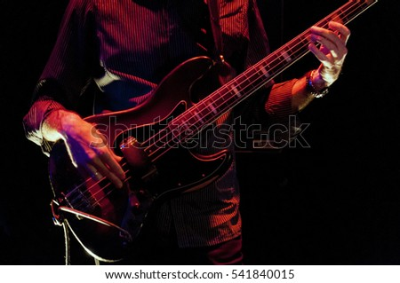 bass guitar player live on stage