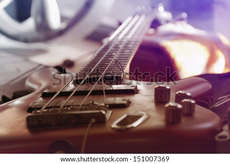 bass guitar with broken string - stock photo
