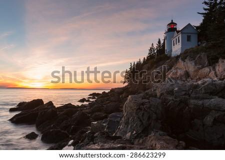 Bass Harbor Lighthouse, Acadia National Park, Maine, USA, at sunset - stock photo