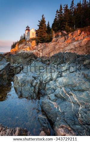 Bass Harbor Lighthouse at sunrise, Acadia National Park, Maine, USA - stock photo