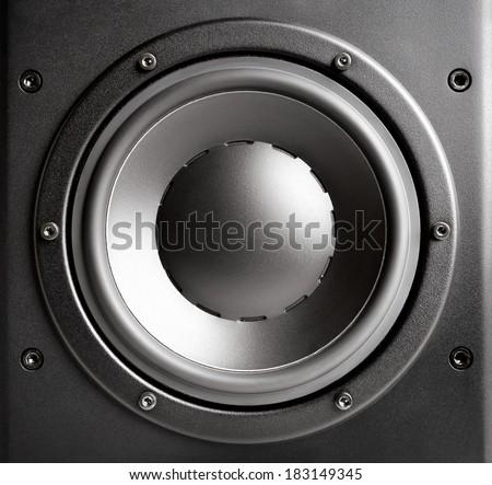 Bass loudspeaker closeup, black, studio shot - stock photo