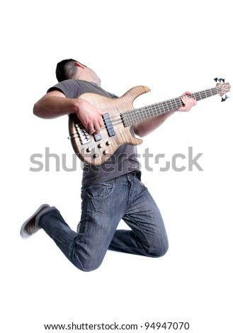 Bass player jumping, isolated over white background - stock photo