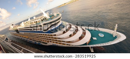 BASSETERRE - DECEMBER 25: Airdabella cruise shop arrives in Basseterre, St Kitts in the morning of December 25, 2014. The budget cruise line caters to European tourists - stock photo
