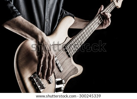 bassist playing electric bass guitar, effect picture - stock photo