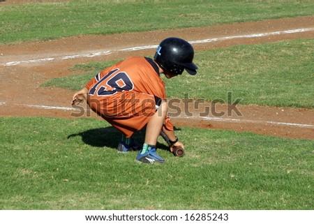 Bat Boy on the Baseball Field - stock photo