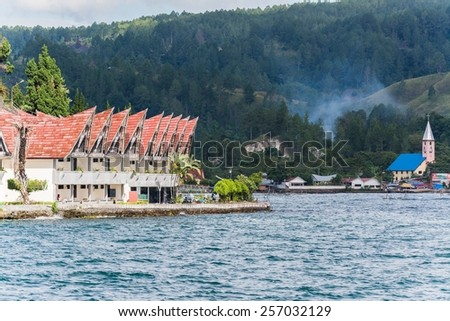 Batak houses in Sumatra, indonesia - stock photo