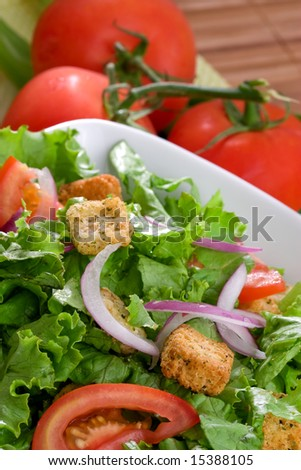 Batavian lettuce with tomatoes and croutons - stock photo
