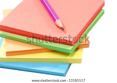 Batch of assorted color paper over white background