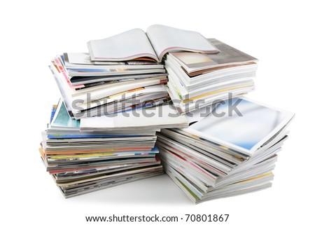 Batch of magazines isolated on white - stock photo