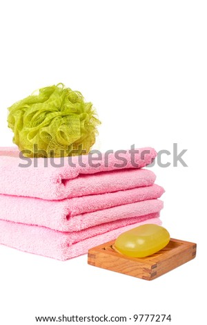 Bath accessories and beauty products reflected on white background - stock photo