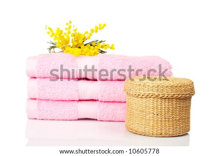 Bath accessories and beauty products reflected on white background. Shallow DOF - stock photo