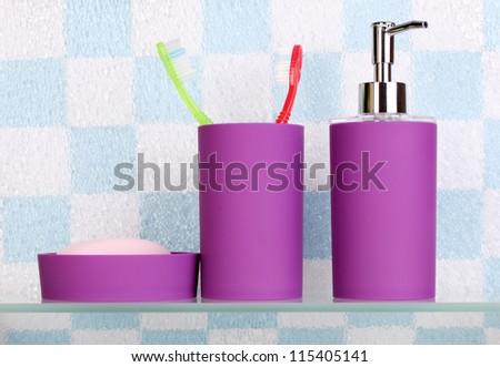 Bath accessories on shelf in bathroom - stock photo