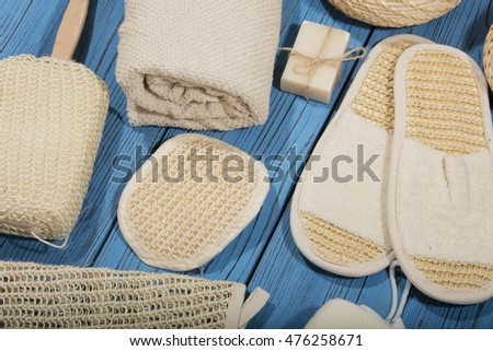 bath and spa accessories on blue wooden background