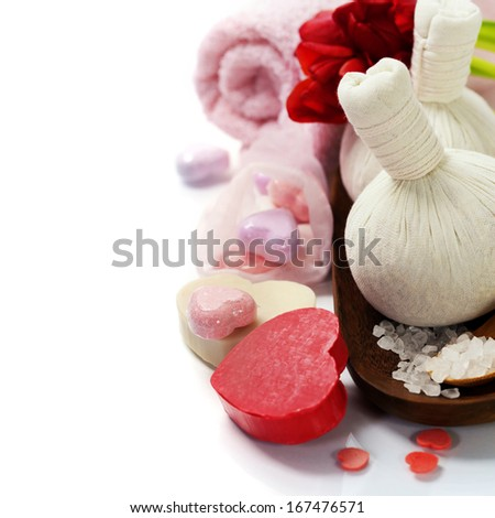 Bath and spa Valentine theme with thai herbal compress stamps, towel, bath soaps and tulips - stock photo