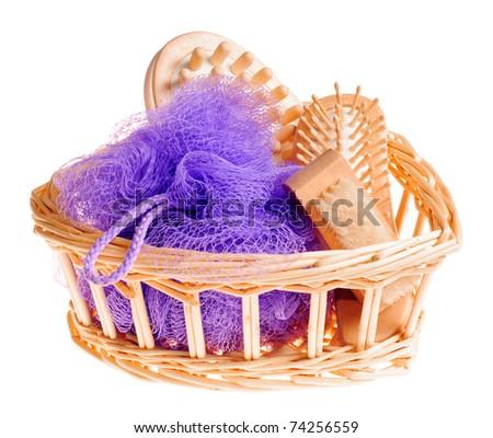 Bath anti-cellulitis spa massage kit with comb, brush, sponge and hairbrush in basket isolated on white background - stock photo