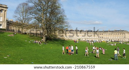 BATH - APR 4: Unidentified people gather in Victoria Park below the landmark Royal Crescent on Apr 4, 2011 in Bath, UK. Bath is a UNESCO World Heritage city with over 3.8 million visitors per year.  - stock photo