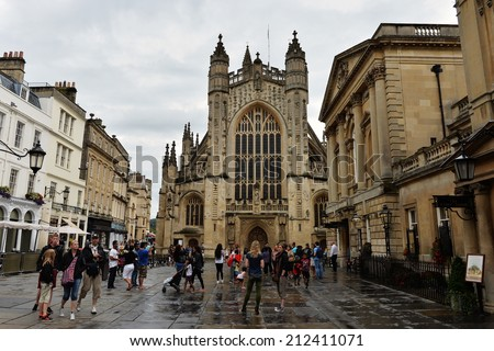 BATH - AUG 9: Tourists and locals gather in the courtyard of the historic Bath Abbey and Roman Baths on Aug 9, 2014 in Bath, UK. A UNESCO world heritage city, Bath receives 4.5mn visitors a year. - stock photo