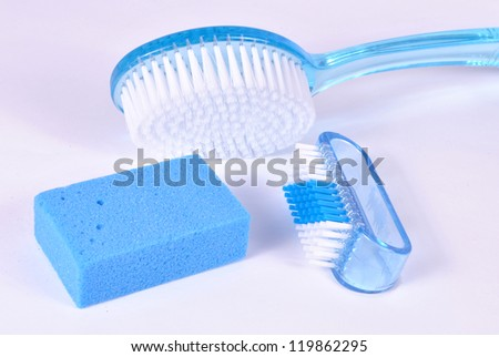 Bath brush and pumice on white