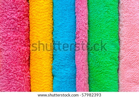 Bath colorful towels on isolated - stock photo