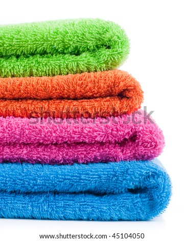 Bath colorful towels. Stack into one pile - stock photo