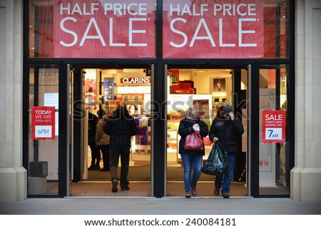 BATH - DEC 25: People visit stores in Southgate shopping district for the Boxing Day Sales on Dec 25, 2014 in Bath, UK. Many stores across the country traditionally hold sales on Boxing Day.    - stock photo
