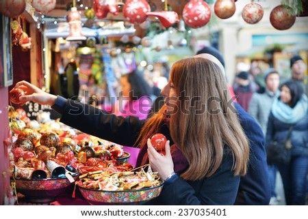 BATH - DEC 8: People visit the Christmas Market in the streets surrounding Bath Abbey on Dec 8, 2014 in Bath, UK. The landmark Somerset city is home to many local and international stores and shops.   - stock photo