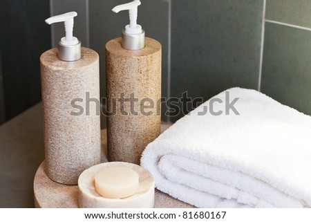 bath dispensers, soap and white towel on the tray - stock photo