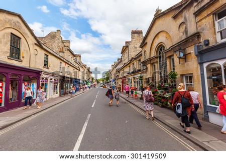 BATH, ENGLAND - JUNE 28, 2015: street view of Bath, with unidentified people. Bath is known for the curative Roman-built baths that still exist there and is is a UNESCO world heritage site since 1987  - stock photo