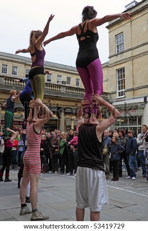 BATH, ENGLAND - MAY 14: Acrobats  perform outside the Pump Rooms in Bath, England on May 14, 2010. Adjacent to Bath Abbey, this is the main site for street entertainers in this tourist city.