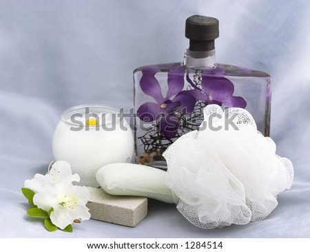 bath essentials with chamomile candle - stock photo