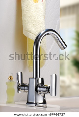 BATH FAUCET - stock photo