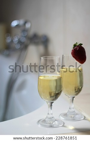 Bath for two with champagne and strawberries - stock photo