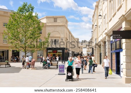 BATH - JUL 26: People walk on a busy street in Southgate shopping district on Jul 26, 2010 in Bath, UK.  Bath is a famous UNESCO World Heritage status city, with over 4 million visitors per year. - stock photo