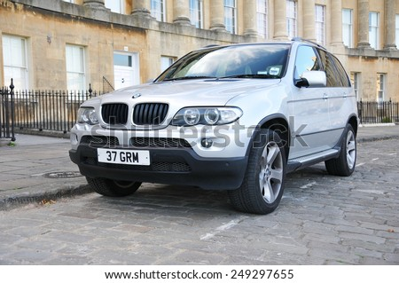 BATH - JUL 26: View of a BMW X5 3.0i on the landmark Royal Crescent on Jul 26, 2010 in Bath, UK. The X5 is a mid-sized luxury SUV manufactured by BMW since 1999 to the present. - stock photo