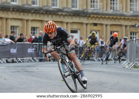 BATH - JUN 11: Cyclists ride in the Pearl Izumi Tour Series bicycle race final on Jun 11, 2015 in Bath, UK. The event drew thousands of spectators to the streets of the picturesque Somerset city. - stock photo