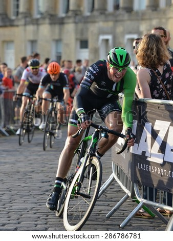 BATH - JUN 11: Cyclists ride past the Royal Crescent in the Pearl Izumi Tour Series bicycle race on Jun 11, 2015 in Bath, UK. The event drew thousands of spectators to the picturesque streets of Bath.