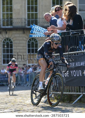 BATH - JUN 11: Dani King rides to victory in the Pearl Izumi Tour Series bicycle race final on Jun 11, 2015 in Bath, UK. The event drew thousands of spectators to the picturesque Somerset city. - stock photo