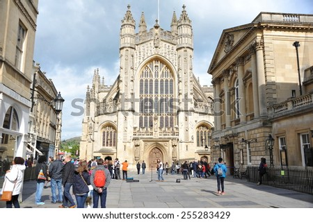 BATH - May 1: Tourists and locals enjoy a sunny day in the courtyard of the historic Bath Abbey and Roman Baths on May 1, 2014 in Bath, UK. The Somerset city receives over 3.8 million visitors a year. - stock photo