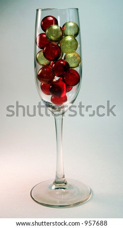 bath oil beads in the royal colors of red and gold. - stock photo