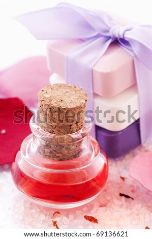 Bath Oil with Rose Petals and Soap - stock photo