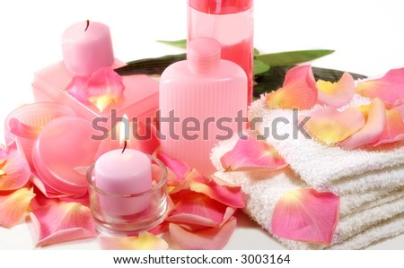 Bath or spa items with pink and yellow rose petals